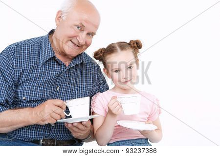 Grandfather having fun with his granddaughter