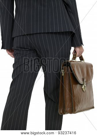 Business Woman with a briefcase, walking, rear view