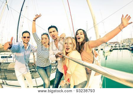 Best Friends Using Selfie Stick Taking Pic On Exclusive Luxury Sailing Boat - Concept Of Friendship