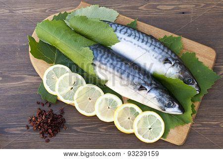 Fresh mackerel in grape leaves with lemon