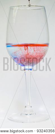 Coloured Food Dye In Wine Glasses
