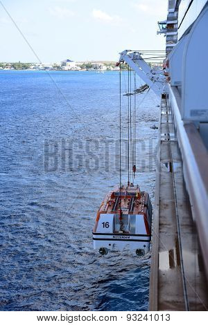 Cruise ships tender winched down to the seas