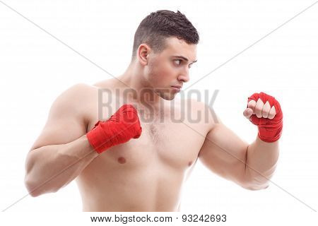 Muscled man doing exercises