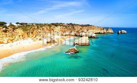 Aerial from natural rocks at Praia Tres Irmaos near Alvor in Por