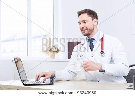 Nice cardiologist drinking tea