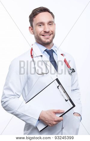 Smiling doctor holding the papers