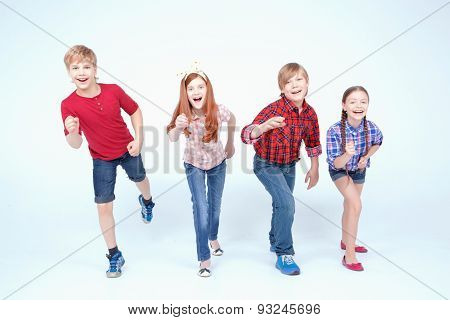 Brightly dressed children smiling