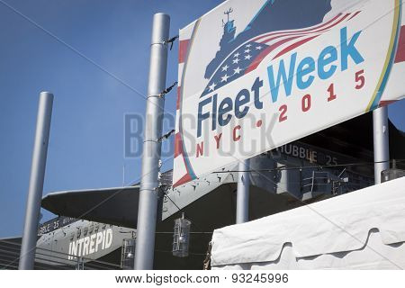 NEW YORK - MAY 22 2015: Fleet Week NYC 2015 banner hangs at Pier 86 in front of the Intrepid Sea Air and Space Museum during Fleet Week NY 2015.