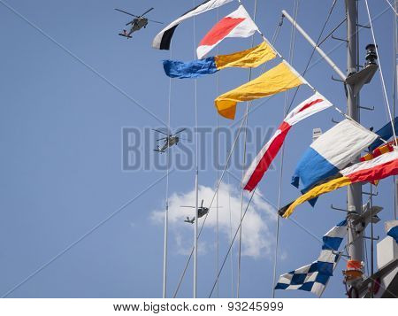 NEW YORK - MAY 22 2015: A group of military helicopters fly above a ships mast over the Intrepid Sea Air and Space Museum at Pier 86 during Fleet Week NY 2015.