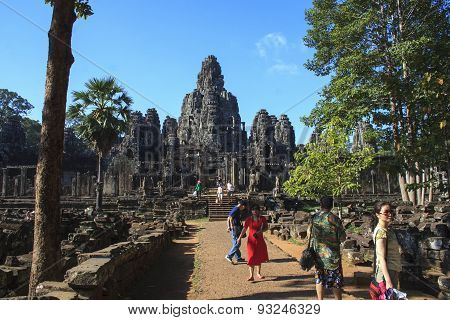 Tourists Walking The Path To And From The Main Temple At Angkor Wat
