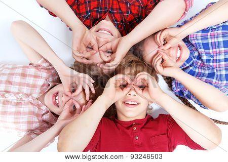 Top view of children lying on the floor