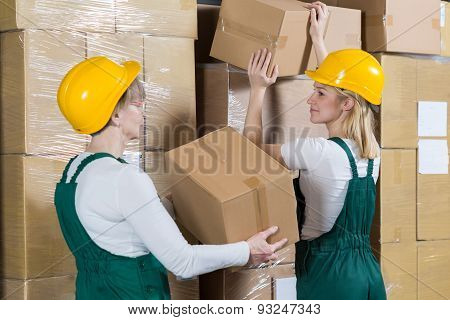 Women Laying The Boxes
