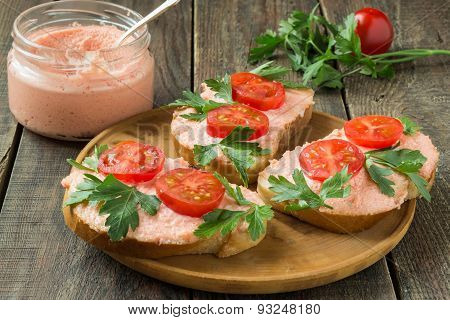 Bruschetta With Salmon Butter, Capelin Caviar, Cherry Tomatoes And Parsley