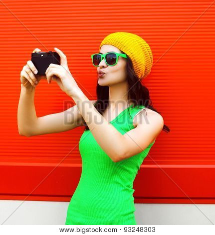 Fashion, Summer, Technology And People Concept - Pretty Cool Girl In Sunglasses Makes Self-portrait