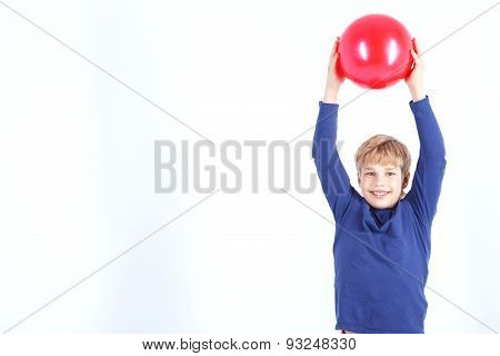 Cheerful boy holding the ball
