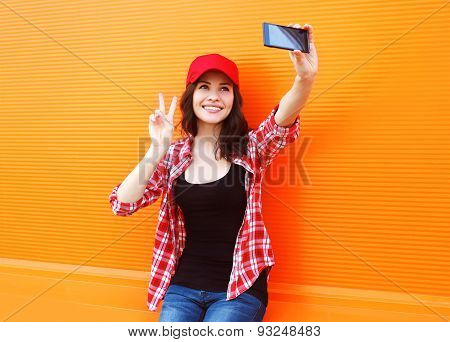 Fashion, Technology And People Concept - Happy Pretty Girl Makes Self-portrait On The Smartphone Out