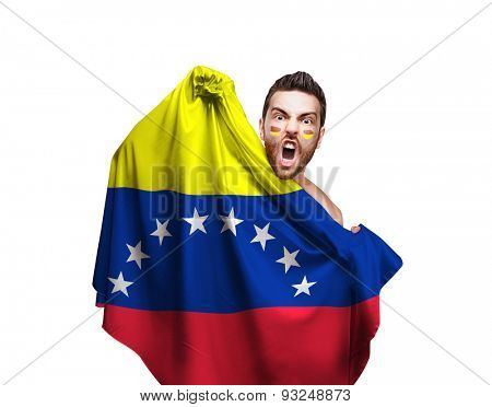 Fan holding the flag of Venezuela on white background