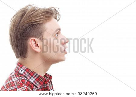 Surprised young guy standing half-face