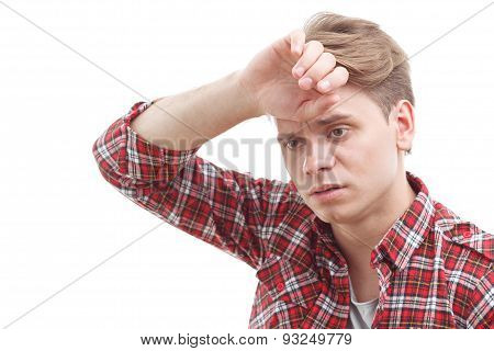 Exhausted guy holding his hand on the forehead.