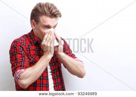 Ill guy holding handkerchief
