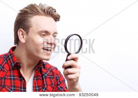 Agreeable guy keeping loupe