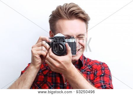 Vivacious guy holding camera