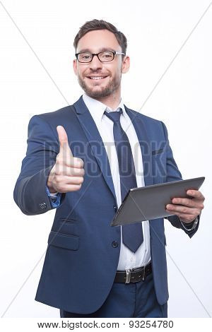 Nice businessman holding the laptop