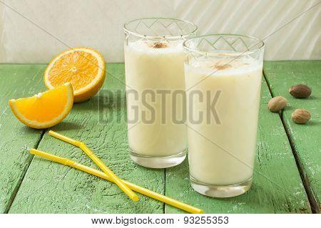 Homemade Fresh Milkshake With Orange, Ice Cream And Nutmeg