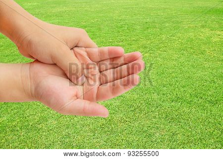 Hand Pain On Green Grass Background