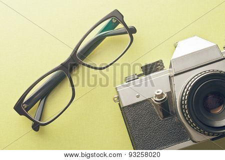 the vintage camera and glasses
