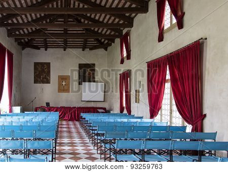 Conference Hall In Ancient Villa With Canvas Blue Chairs And Red Curtains