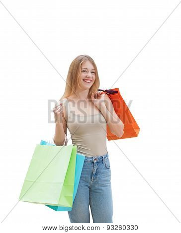 A Happy Young Woman With The Colourful Shopping Bags From The Fancy Shops. Isolated.