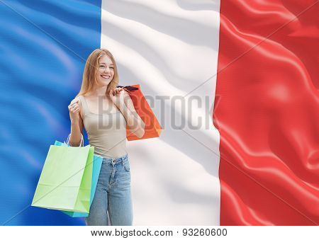 A Happy Young Woman With The Colourful Shopping Bags From The Fancy Shops. French Flag Background.