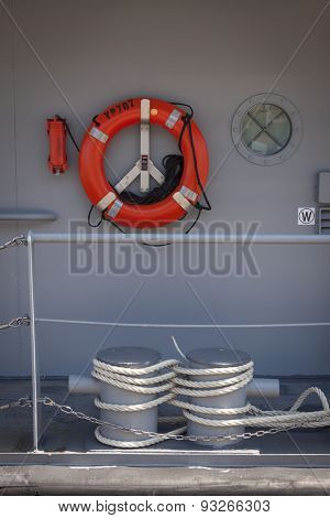 NEW YORK - MAY 22 2015: Lines around mooring bollards and life ring on a US Naval Academy Yard Patrol Craft used for at-sea training and research by students, moored at Pier 86 for Fleet Week NY 2015.