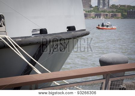 NEW YORK - MAY 22 2015: The bow of YP 704 US Naval Academy Yard Patrol Craft used for at-sea training and research with a USCG patrol boat in the background, moored at Pier 86 for Fleet Week NY 2015.