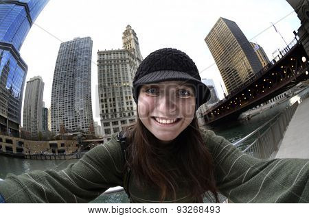 Teen teenager tourist girl taking selfie with camera in Chicago