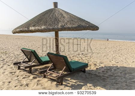 Chairs and umbrella on a tropical beach