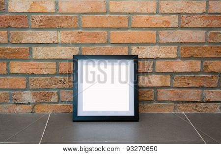 Blank Black Picture Frame On The Old Brick Wall