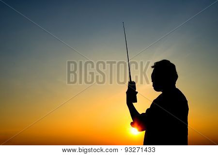 silhouette man with radio communication