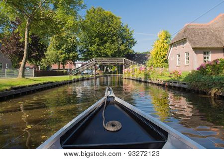With boat in village Giethoorn in Holland