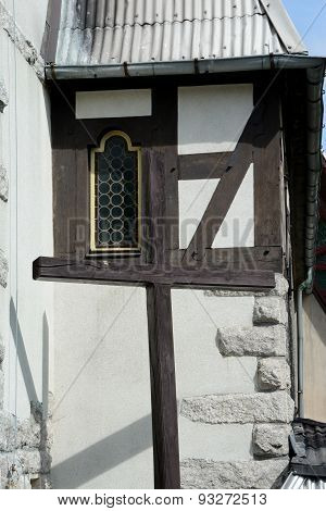Wooden Cross And Small Stained Glass Window
