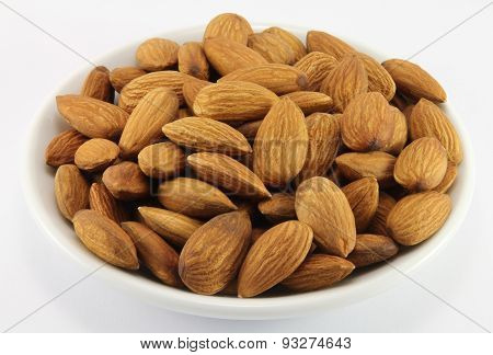 Handful Of Almonds On A White Porcelain Dish