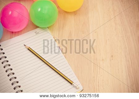 Back to school background with notebook and colorful ball, vintage tone image