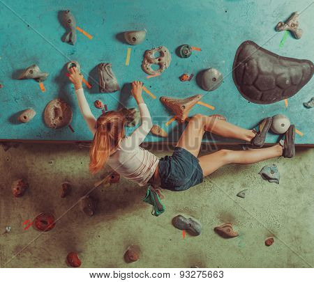 Little Girl Training In Climbing Gym