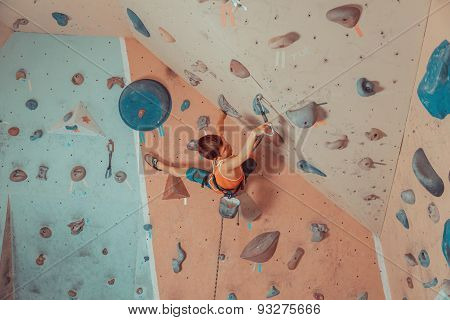 Boy In Safety Equipment Climbing Indoor