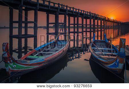 Sunset In U Bein Bridge With Vintage Boat