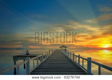 Sunset And Wooded Bridge