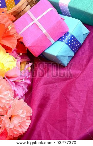 Present Gift Box And Flower Bouquet On Silk