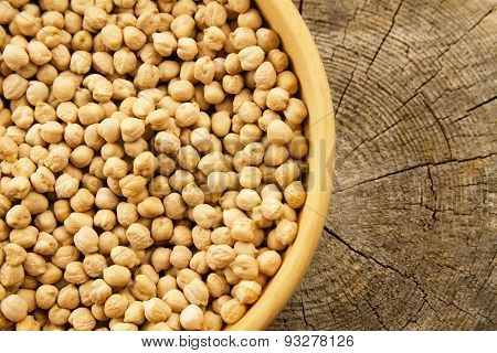 Bunch Of Chickpeas In A Bowl On Old Wooden Background. Indian Cuisine