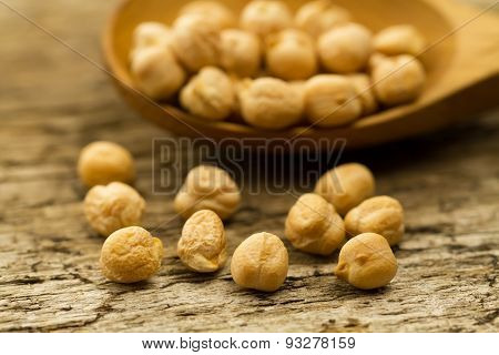 Scattered Chickpeas From A Jute Bag With A Spoon On Old Wooden Background